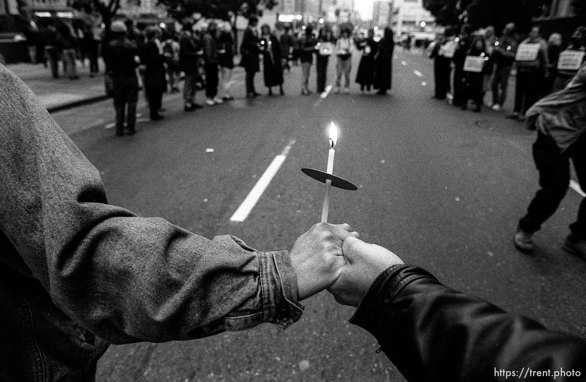 Protesters hold hands and candles at Gulf War protest Federal Building blockade