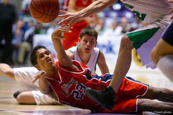 Ogden - Granger's T. J. Tapusoa tries to get the ball from the floor to a teammate. Provo's Scott Edwards at rear. Provo vs. Granger High School boys basketball, 4A State Basketball Championships at the Dee Events Center Wednesday.