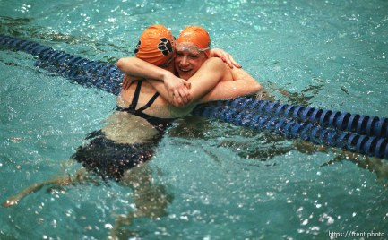 Brighton swimmers Lori Bednarchik (right) and Melissa Beutler embrace after placing 1st (LB) and 3rd (MB) at the 5A high school swimming finals.