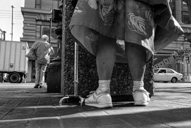 Woman's legs. Leica hip shots on the street.