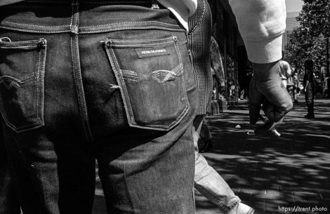 Man's butt and cigarette. Leica hip shots on the street.