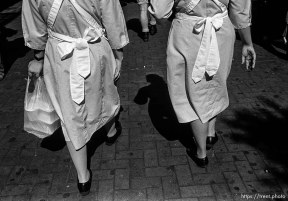 Women in white dresses (their backs and legs). Leica hip shots on the street.