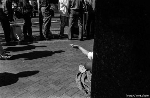 Beggar. Leica hip shots on the street.