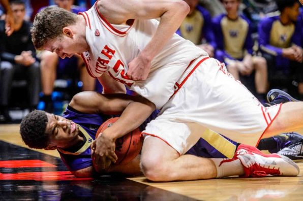 Trent Nelson | The Salt Lake Tribune Washington Huskies forward Marquese Chriss (0) and Utah Utes forward Jakob Poeltl (42) in a scramble as the University of Utah Utes host the Washington Huskies, NCAA basketball at the Huntsman Center in Salt Lake City, Wednesday February 10, 2016.