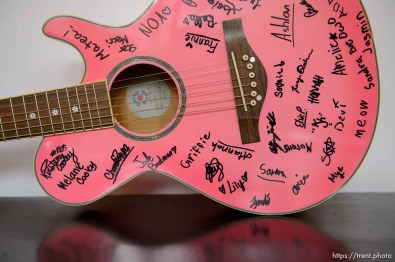 An autographed pink guitar at Rock Camp for Womyn. People attending the camp learn how to play instruments, form bands, write songs, and perform live in concert — all in three days. It's a new program by the same group that does Rock and Roll Camp for Girls. Salt Lake City, Friday February 2, 2018.