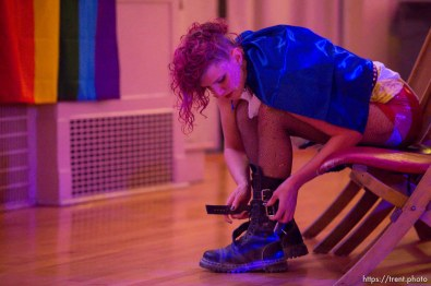 Frieda Hamilton puts on a pair of boots before Rock Camp for Womyn's showcase, a live performance. People attending the camp learn how to play instruments, form bands, write songs, and perform live in concert — all in three days. It's a new program by the same group that does Rock and Roll Camp for Girls. Salt Lake City, Sunday February 4, 2018.