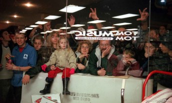 Fans who couldn't get in to the Smashing Pumpkins appearance crowded around the windows outside Tom Tom Music, a record store in Sandy. photo by Trent Nelson; 02/03/2000