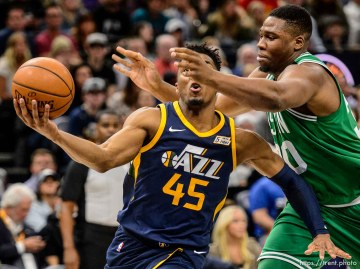 (Trent Nelson | The Salt Lake Tribune) Utah Jazz vs. Boston Celtics, NBA basketball in Salt Lake City, Wednesday March 28, 2018. Utah Jazz guard Donovan Mitchell (45) and Boston Celtics forward Guerschon Yabusele (30).