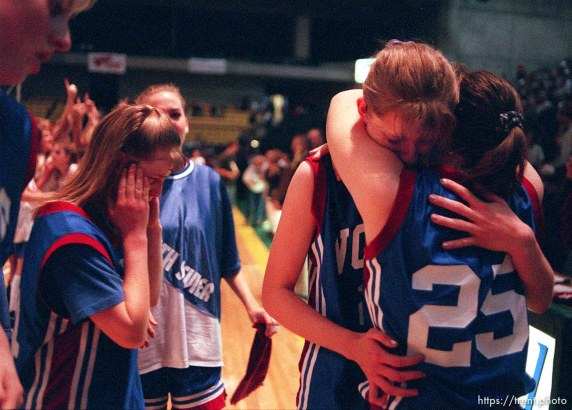 North Sevier basketball players grieve at their loss in the state championship to Beaver. From left, (top left corner) Angie Hawkins, Chasity Peterson, Danielle Andreasen, Angie Braithwaite, Shadoe Shaheen.