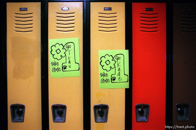 Signs of encouragement left on the lockers of North Sevier boys basketball players Travis Story and Kade Hallows.