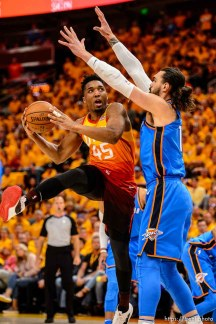 (Trent Nelson | The Salt Lake Tribune) Utah Jazz host the Oklahoma City Thunder, Game 3, NBA playoff basketball in Salt Lake City, Saturday April 21, 2018. Utah Jazz guard Donovan Mitchell (45) defended by Oklahoma City Thunder center Steven Adams (12).