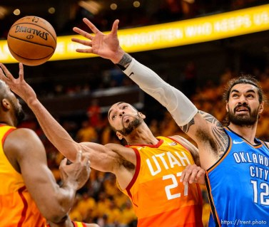 (Trent Nelson | The Salt Lake Tribune) Utah Jazz host the Oklahoma City Thunder, Game 3, NBA playoff basketball in Salt Lake City, Saturday April 21, 2018. Utah Jazz center Rudy Gobert (27) and Oklahoma City Thunder center Steven Adams (12).