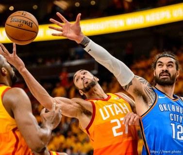 (Trent Nelson | The Salt Lake Tribune) Utah Jazz host the Oklahoma City Thunder, Game 3, NBA playoff basketball in Salt Lake City, Saturday April 21, 2018. Utah Jazz center Rudy Gobert (27) and Oklahoma City Thunder center Steven Adams (12).