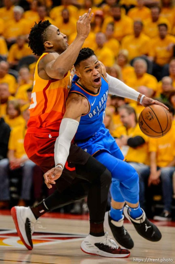 (Trent Nelson | The Salt Lake Tribune) Utah Jazz host the Oklahoma City Thunder, Game 3, NBA playoff basketball in Salt Lake City, Saturday April 21, 2018. Utah Jazz guard Donovan Mitchell (45) fouls Oklahoma City Thunder guard Russell Westbrook (0).