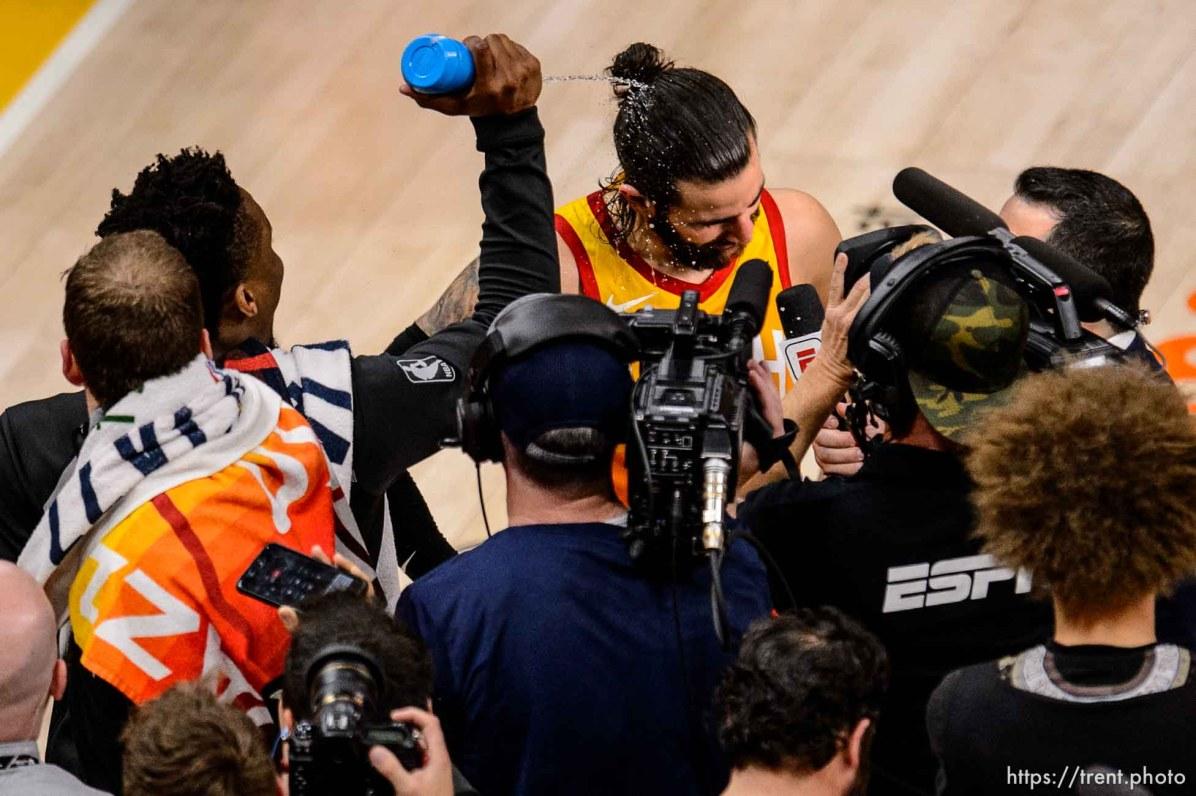 (Trent Nelson | The Salt Lake Tribune) Utah Jazz host the Oklahoma City Thunder, Game 3, NBA playoff basketball in Salt Lake City, Saturday April 21, 2018. Utah Jazz guard Donovan Mitchell (45) sprays Utah Jazz guard Ricky Rubio (3) with water.