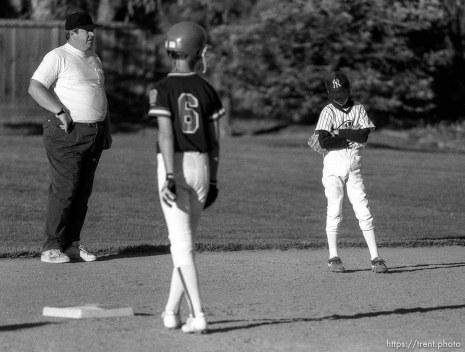 Player hangs head at Yankees baseball game.