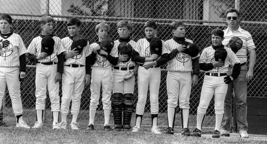 Players during national anthem at Yankees game.