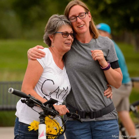 (Trent Nelson | The Salt Lake Tribune) Cyclists gather and ride around Salt Lake City's Liberty Park, Saturday July 21, 2018, in remembrance of Cameron Hooyer, a rider who was killed by a FrontRunner train during a 999 Ride on Thursday. Hooyer's mother Carla, left, is comforted.