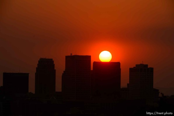 (Trent Nelson | The Salt Lake Tribune) The sun sets over a hazy Salt Lake City, Monday Aug. 6, 2018.