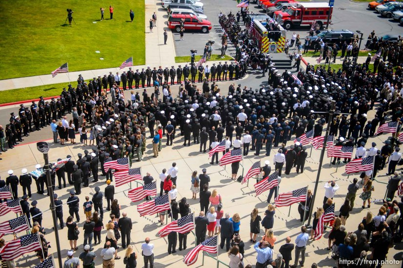 (Trent Nelson | The Salt Lake Tribune) Funeral services for Battalion Chief Matthew Burchett at the Maverik Center in West Valley City, Monday Aug. 20, 2018.