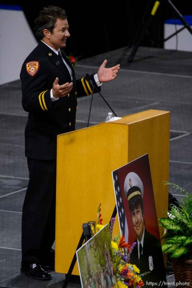 (Trent Nelson | The Salt Lake Tribune) Dominic Burchett (brother) encourages the audience to get up and make some noise at the funeral services for Battalion Chief Matthew Burchett at the Maverik Center in West Valley City, Monday Aug. 20, 2018.