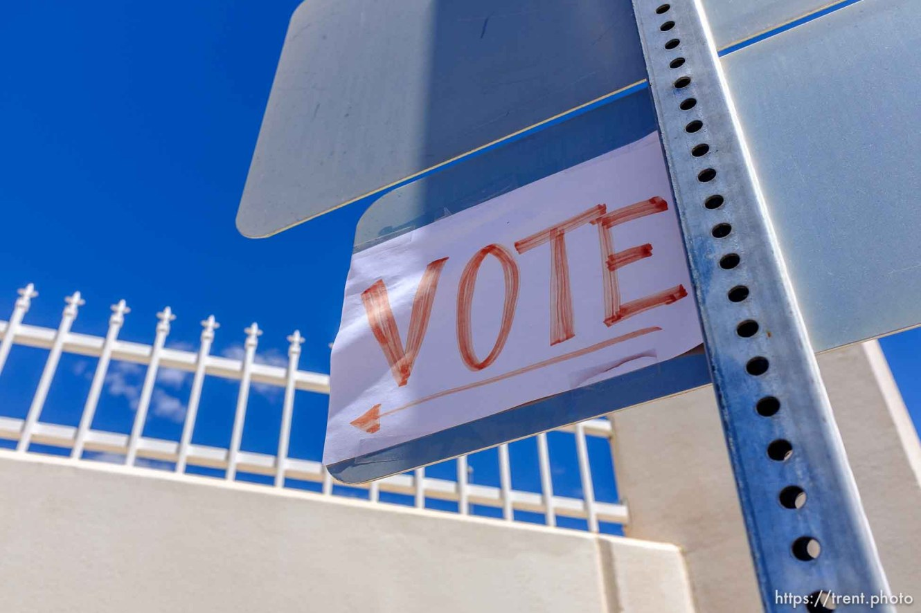 Trent Nelson | The Salt Lake Tribune Posted in front of a mansion constructed for imprisoned FLDS leader Warren Jeffs, a sign encourages locals to vote in a primary in Hildale, Monday May 1, 2017.