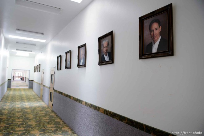 Trent Nelson | The Salt Lake Tribune Portraits of FLDS prophets including, from right, Warren Jeffs, Rulon Jeffs, and Leroy Johnson, line the hallway in an FLDS school in Colorado City, Ariz., one of a few sites being considered for use as an LDS meetinghouse. The property is owned by the UEP land trust, which is seeking to dispose of its holdings. Tuesday May 23, 2017.
