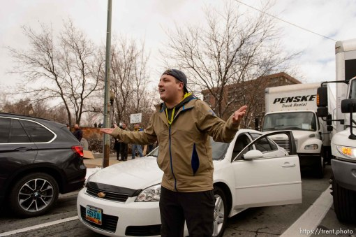 (Trent Nelson   The Salt Lake Tribune) A motorist argues with protesters after they blocked off an interception after a rally against a visit by President Donald Trump, Monday December 4, 2017.