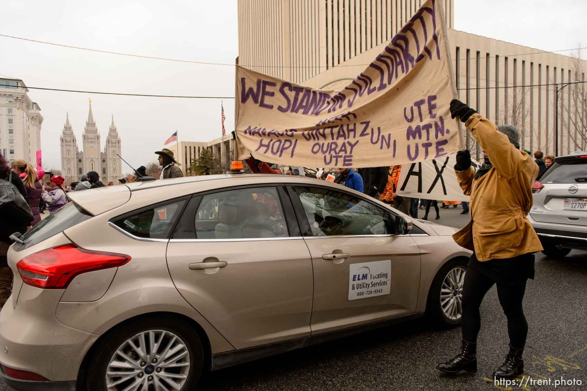 (Trent Nelson | The Salt Lake Tribune) Protesters march down State Street through traffic after a rally against a visit by President Donald Trump, Monday December 4, 2017.