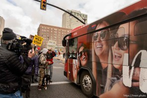 (Trent Nelson   The Salt Lake Tribune) Protesters let a bus through an intersection they had blocked off downtown after a rally against a visit by President Donald Trump, Monday December 4, 2017.