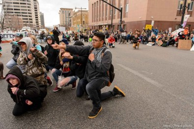 (Trent Nelson | The Salt Lake Tribune) Protesters block an intersection downtown after a rally against a visit by President Donald Trump, Monday December 4, 2017.