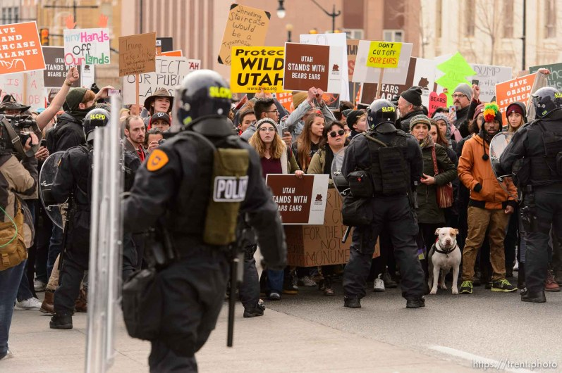 (Trent Nelson | The Salt Lake Tribune) Police and protesters downtown after a rally against a visit by President Donald Trump, Monday December 4, 2017.