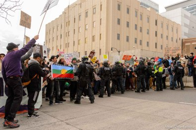 (Trent Nelson   The Salt Lake Tribune) Protesters square off with a line of police after a rally against a visit by President Donald Trump, Monday December 4, 2017.