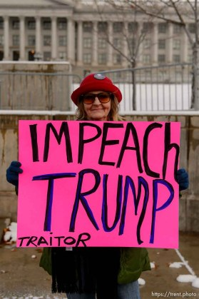 (Trent Nelson | The Salt Lake Tribune) Kris Moore holds up a sign as protesters gather before a visit by President Donald Trump, Monday December 4, 2017.