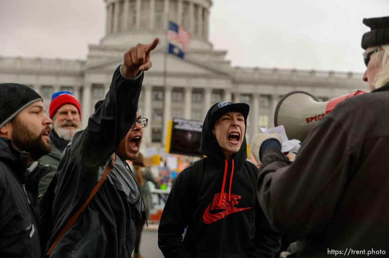 (Trent Nelson   The Salt Lake Tribune) Protesters try to drown out a man trolling them with a megaphone at a rally against a visit by President Donald Trump, Monday December 4, 2017.