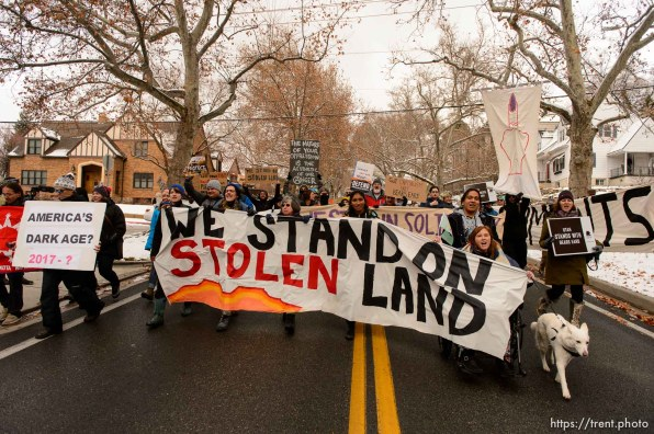 (Trent Nelson | The Salt Lake Tribune) Protesters march down State Street during rally against a visit by President Donald Trump, Monday December 4, 2017.