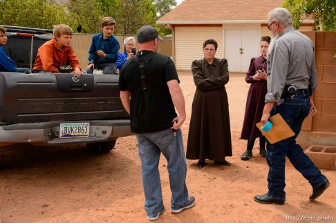 Trent Nelson | The Salt Lake Tribune An FLDS woman confronts UEP agent Ted Barlow and Mohave County Constable Mike Hoggard as they evict her from a home in Colorado City, Ariz., Tuesday May 9, 2017.