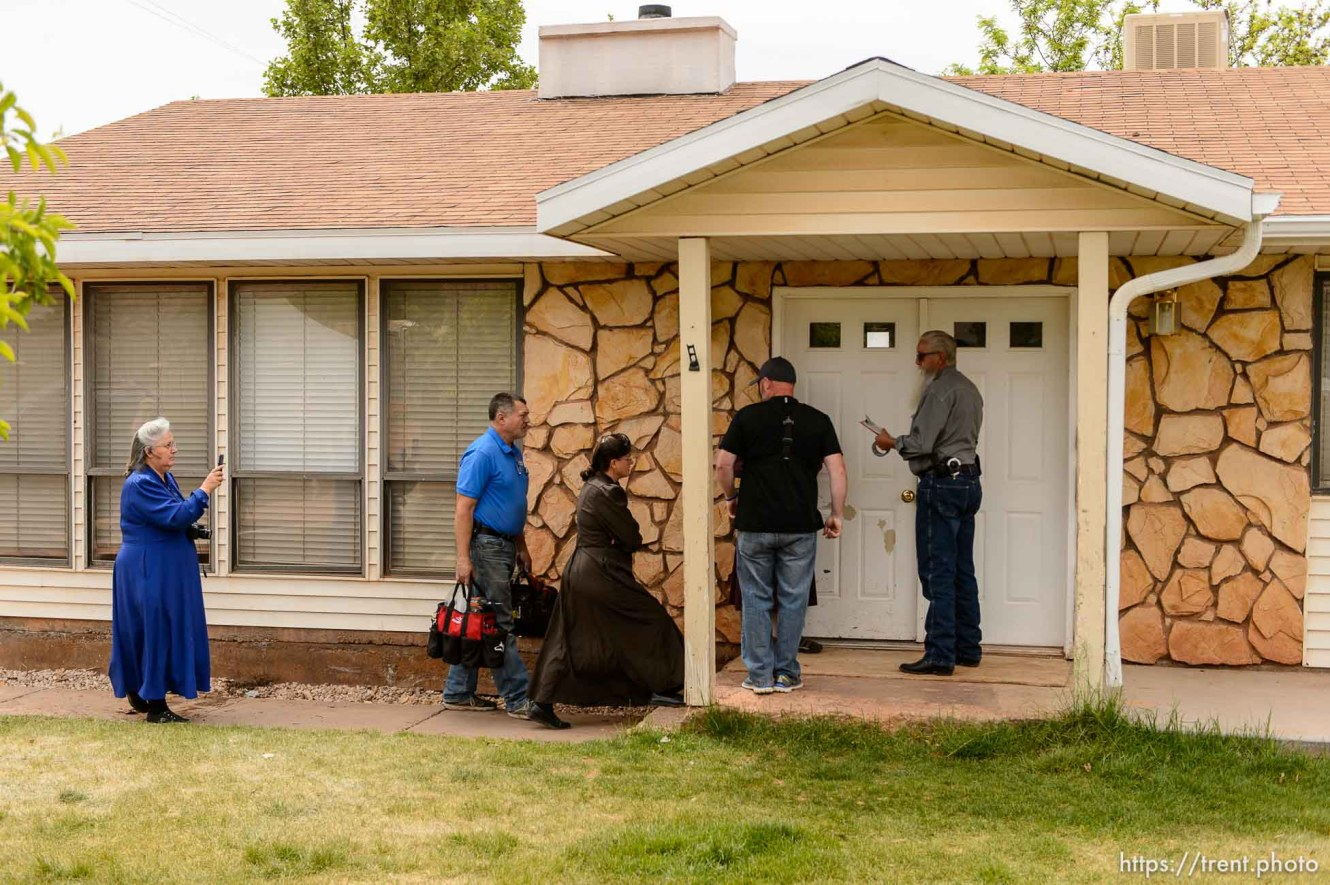 Trent Nelson   The Salt Lake Tribune An FLDS woman confronts UEP agent Ted Barlow and Mohave County Constable Mike Hoggard as they evict her from her home in Colorado City, AZ, facing eviction, Tuesday May 9, 2017. Locksmith Kelvin Holdaway in blue shirt.