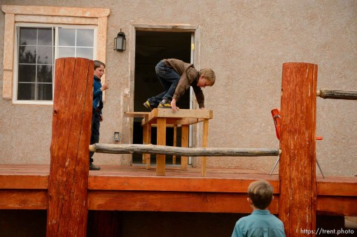 Trent Nelson | The Salt Lake Tribune FLDS boys move a table from their Colorado City, AZ, home as they're evicted, Tuesday May 9, 2017.