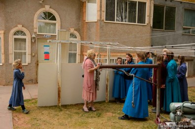 Trent Nelson | The Salt Lake Tribune Christine Marie Katas talks with FLDS women and girls about housing options as they're evicted from their Colorado City, AZ, home, Tuesday May 9, 2017.