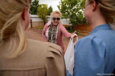 Trent Nelson | The Salt Lake Tribune Christine Marie Katas hands out relief kits to FLDS women in Colorado City, AZ, Tuesday May 9, 2017, as the locks are changed on the home next door by the UEP Trust.