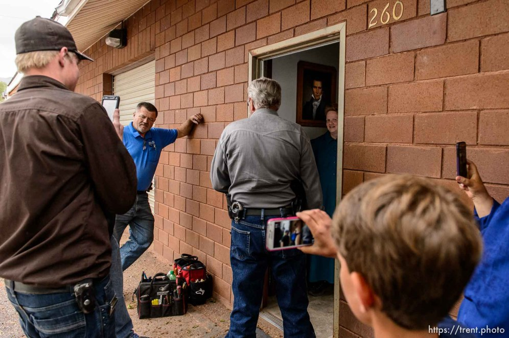 Trent Nelson | The Salt Lake Tribune FLDS member Julia Johnson confronts Mohave County Constable Mike Hoggard, disputing the UEP Trust's ability to evict her from a property in Colorado City, AZ, Tuesday May 9, 2017. Locksmith Kelvin Holdaway in blue.