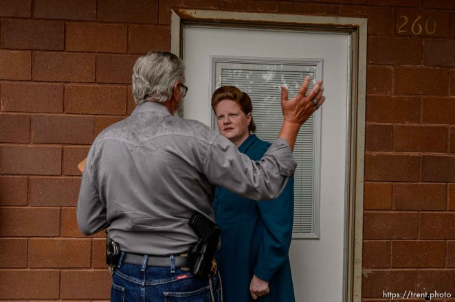 Trent Nelson   The Salt Lake Tribune FLDS member Julia Johnson confronts Mohave County Constable Mike Hoggard, disputing the UEP Trust's ability to evict her from a property in Colorado City, AZ, Tuesday May 9, 2017.