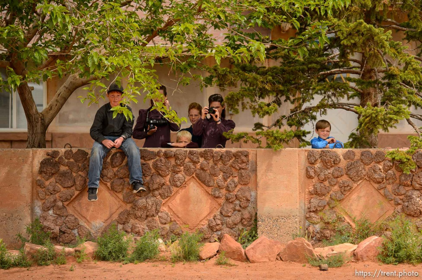 Trent Nelson   The Salt Lake Tribune A group of FLDS children, themselves facing eviction, watch and take photos of a woman being evicted from her home in Colorado City, AZ, Tuesday May 9, 2017.