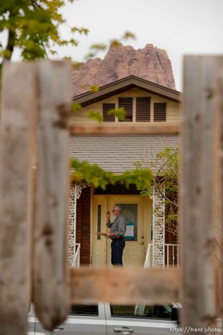 Trent Nelson   The Salt Lake Tribune Seen through a hole in a fence, Mohave County Constable Mike Hoggard checks a home for occupants during its eviction in Colorado City, Ariz., Tuesday May 9, 2017.