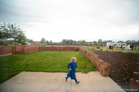 Trent Nelson | The Salt Lake Tribune FLDS children look on as a Colorado City, AZ, home across the street has its locks changed in an eviction by the UEP Trust, Tuesday May 9, 2017.
