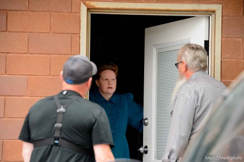 Trent Nelson | The Salt Lake Tribune FLDS member Julia Johnson confronts Mohave County Constable Mike Hoggard, disputing the UEP Trust's ability to evict her from a property in Colorado City, AZ, Tuesday May 9, 2017. Ted Barlow at left.