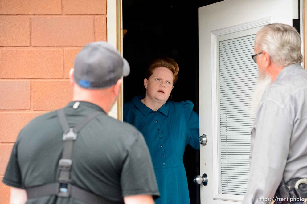 Trent Nelson   The Salt Lake Tribune FLDS member Julia Johnson confronts Mohave County Constable Mike Hoggard, disputing the UEP Trust's ability to evict her from a property in Colorado City, AZ, Tuesday May 9, 2017. Ted Barlow at left.