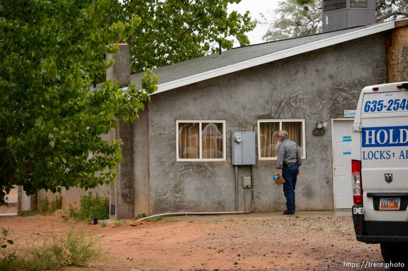 Trent Nelson | The Salt Lake Tribune Two FLDS women are evicted from a home in Colorado City, AZ, Tuesday May 9, 2017, and walk off in the rain. Mohave County Constable Mike Hoggard.