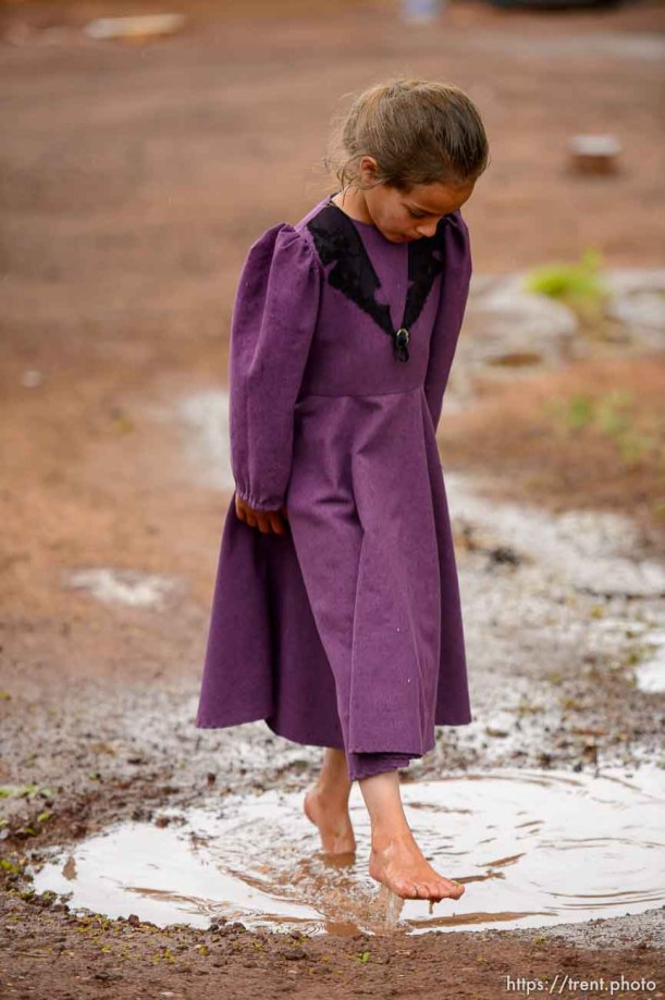 Trent Nelson   The Salt Lake Tribune The locks are changed on an empty home in Colorado City, AZ, Tuesday May 9, 2017, as part of the UEP Trust evictions. FLDS girl in puddle